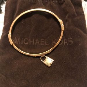 Michael Kors gold lock bracelet with diamonds.